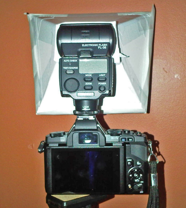 Olympus OM-D EM-5 camera and FL36 flash with diffuser made from foamcore, white duct tape and paper (back view)